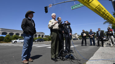 San Diego County Sheriff Bill Gore, centre, addresses the media outside  the Chabad of Poway Synagogue.