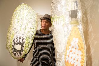 Artist Jumaadi with his work at Mosman Art Gallery.
