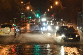 Pittwater Road at Dee Why earlier on Tuesday morning, as heavy rain and winds affect road conditions in Sydney.