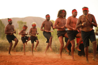 The Indigenous community celebrates the closure of the Uluru climb in October.