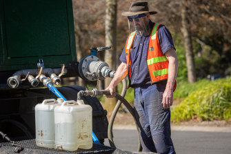 Residents collected clean drinking water from a tanker in the car park of the Ferntree Gully Arboretum on Saturday.