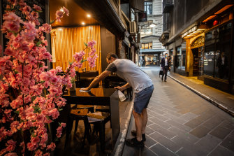 Nick Brewer prepares to open his cafe Issus on Melbourne's Degraves Street.