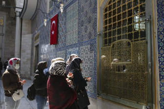 Women attend mosque in Istanbul on April 12.