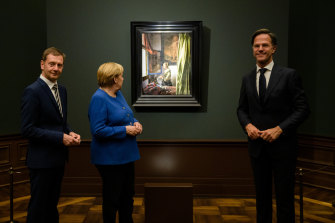 Stands out: Dutch Prime Minister Mark Rutte, 193cm, right, with Prime Minister of Saxony Michael Kretschmer, left, and German Chancellor Angela Merkel, in Dresden, Germany, earlier this month.