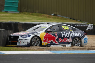 Jamie Whincup gets bogged in a sand-trap at Sandown on Friday.