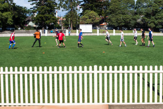 A group of 10 play football at Chatswood Oval on Sunday.