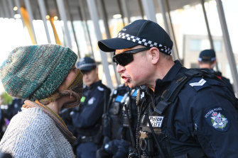 Environmental protesters clash with Police outside the Melbourne Exhibition and Convention Centre on Tuesday as they attempted to disrupt an international mining conference.