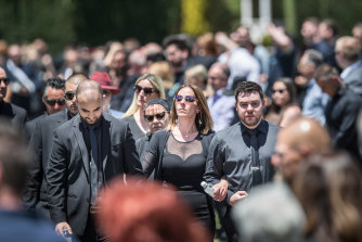 Celeste Manno's mother, Aggie DiMauro, brother Alessandro and boyfriend, Chris Ridsdale (right), leave the service in Whittlesea.