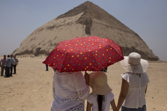 People visit the Bent Pyramid during an event opening the pyramid and its satellites for visitors in Dahshur, Egypt.