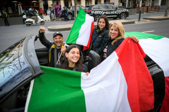 John Mandorla celebrates Italy's semi-final win with his wife Julie and their two daughters Klarissa (centre) and Liana.