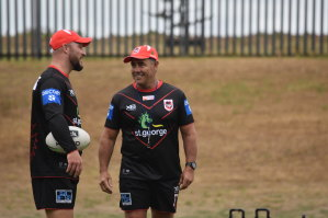 Shane Flanagan chats with fellow Dragons assistant Dean Young.
