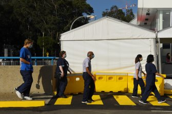 NSW Health workers arrive at Westmead Hospital's vaccination hub.