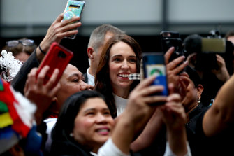 New Zealand Prime Minister Jacinda Ardern poses for photos in Auckland on Friday.