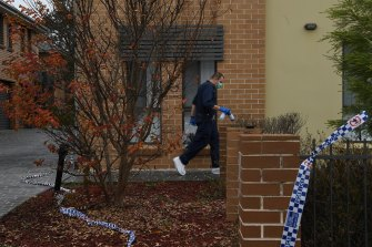 A forensic officer at a home in Quakers Hill where a woman was fatally stabbed on Wednesday night.