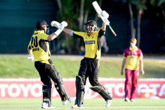 Shaun Marsh (left) and Ashton Agar celebrate WA's four-wicket victory on Tuesday.