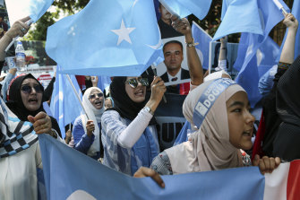 Uighurs with separatist flags of East Turkestan protest outside the Chinese consulate in Istanbul in July.