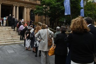 People arrive at Sydney's Town Hall for the memorial of Jack Mundey on Wednesday.