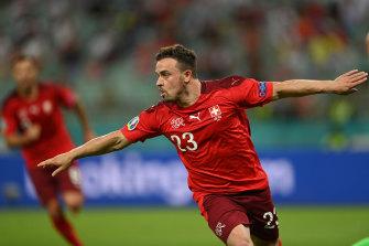 Xherdan Shaqiri after scoring for Switzerland against Turkey.