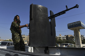 Raman Qamishlo mans a heavy weapon patrolling the streets of Qamishli.