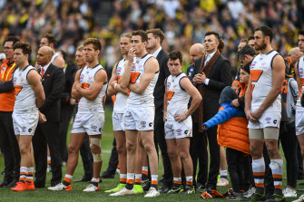The Giants watch on as the Tigers celebrate during the post-match presentation.