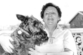 """Writer Eleanor Witcombe photographed with her pet """"Mrs McGregor"""", Woolwich, 1977."""