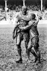 Gladiators: John O'Gready's iconic image of St George captain Norm Provan and Wests' Arthur Summons after the 1963 grand final.