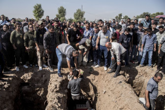 People attend funerals of fighters of the Syrian Democratic Forces killed fighting the Turkish advance, in the town of Qamishli, northern Syria, on Wednesday.