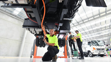 Technician Norman Bell works on an electric truck in Dandenong South.