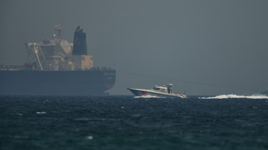 An Emirati coast guard vessel passes an oil tanker off the coast of Fujairah, United Arab Emirates.