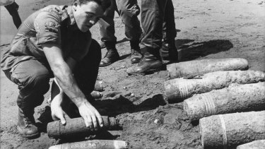 The Australian 1st Field Engineer Regiment stack live World War II artillery shells on a Solomon Islands beach. The soldiers had been dispatched on an aid project and after clearing a 10-hectare site, the shells were dumped at sea.