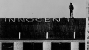 Convicted Whiskey Au Go Go murderer John Andrew Stuart on top of a cell block at Boggo Road where he spelled out 'innocent'.