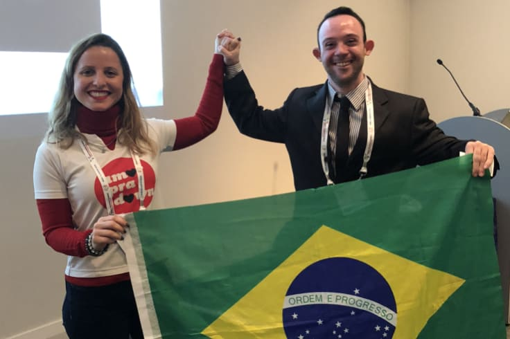 Samuel Sestaro with Jessica Pereira Cardozo, technical coordinator of the Brazilian association Amor Pra Down (Love For Down) after his presentation in Glasgow.
