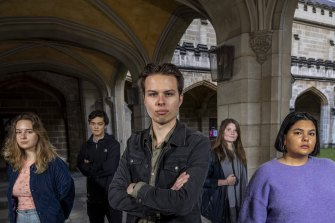 Melbourne University student union president Jack Buksh (centre) says a $7m federal grant would be better spent on staff or subjects.