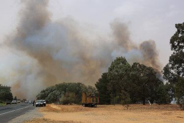 A bushfire burns on January 23, 2020 in Canberra, Australia. The fire on Kallaroo road in Pialligo by Canberra Airport remains at watch and act level, after being downgraded overnight. (Photo by Mark Evans/Getty Images)
