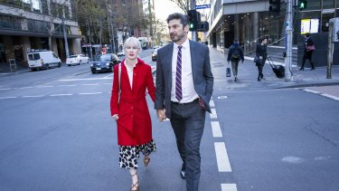 Constantine Arvanitis outside Melbourne's County Court with his fiancee, Melanie Thornton.