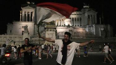 Italian fans celebrate in downtown Rome at the end of the Euro 2020 quarter-final between Belgium and Italy.