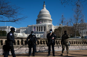US Capitol police officers stand guard  in Washington DC following the riot.