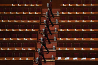 Tea hostesses prepare for the National Committee of the Chinese People's Political Consultative Conference (CPPCC), an advisory body meeting in parallel with the National People's Congress on Friday.