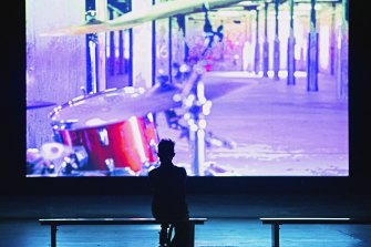 A sole viewer watches the 16-minute performance inside Carriageworks.