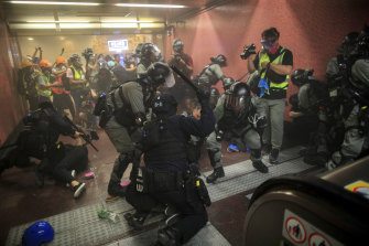 Policemen charge and arrest protesters inside the Tai Koo MTR station during the anti-extradition bill protest in Hong Kong on Sunday night.