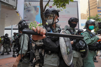 Riot police form a line as they plan to clear away people gathered in the Central district in Hong Kong last week.