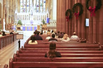 People attend mass at St Mary's Cathederal in Sydney on Wednesday afternoon following the latest COVID-19 social distancing rules.