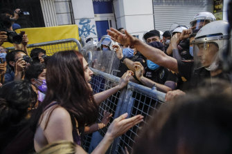 A protester, left, confronts police officers preventing the group from marching against the government's decision to withdraw from Istanbul Convention, on Thursday, July 1, 2021.