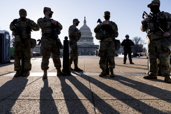 Members of the Michigan National Guard and the US Capitol Police keep watch as heightened security remains in effect around the Capitol.