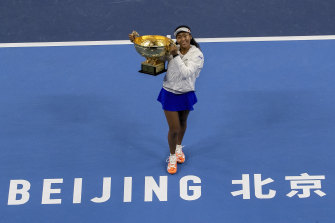 Naomi Osaka of Japan poses with her winner's trophy at the China Open last year.
