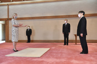 Socially distant but politically close: US first lady Jill Biden meets Japanese Emperor Naruhito, right, at the Imperial Palace in Tokyo before the Olympics opening ceremony on Friday.