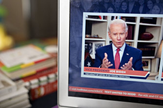 Presumptive Democratic presidential nominee Joe Biden speaks during a virtual event seen on a laptop in Arlington, Virginia.