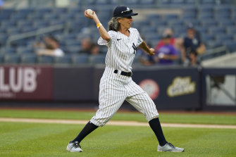 Gwen Goldman throws the ceromonial first pitch at Yankees Stadium.