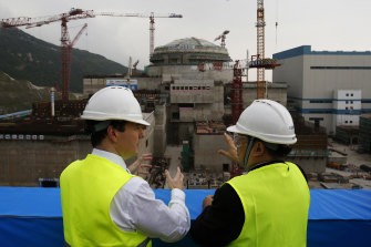A 2013 file photo of the George Osborne, then the UK's Chancellor of the Exchequer, with Taishan Nuclear Power Joint Venture general manager Guo Liming.