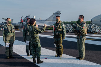 Taiwanese President Tsai Ing-wen speaks with military personnel last week during Taiwan's five-day Han Guang military exercise designed to prepare the island's forces for an attack by China.